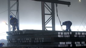 Male workers works in the Foundry. Male workers in action of hard works in the Foundry factory stock video footage