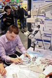 Male working as dental technician. MOSCOW - APRIL 27: Male working as dental technician at the international exhibition of the dental professionals and industry Royalty Free Stock Photography