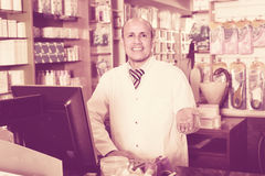 Male working in chemist shop Royalty Free Stock Images