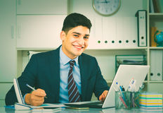 Male is working at a computer Stock Photography