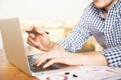 Male working on computer Stock Images