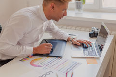 Male working at desktop stock image