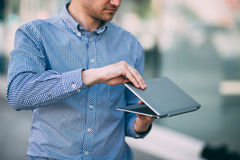 Male working on laptop on street. Modern technology commercial background, unrecognizable man Stock Images