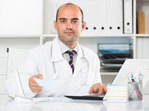 Male working in medical Center at the laptop Stock Image
