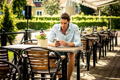 Male working on mobile phone. Well dressed Royalty Free Stock Image