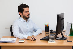 Male working at workstation. Stock Photos