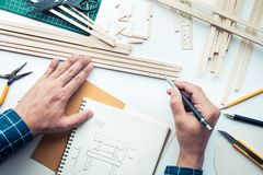 Male working on worktable with balsa wood material.Diy,design. Project,invention concept ideas Stock Photos