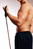 Male with workout straps side. Shirtless male model with workout straps making a muscle in profile Stock Photography