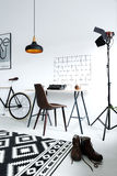 Male workspace with studio lamp. White, male workspace with studio lamp, desk, chair, bike Royalty Free Stock Images