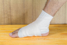 Male is wrapping with bandage. Male is wrapping his Foot injury with bandage Stock Photography