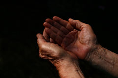 Male Wrinkled old hands begging asking for money, help. Reaching out and compassion concept Royalty Free Stock Photos