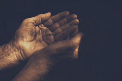 Male Wrinkled old hands begging. compassion concept. Male Wrinkled old hands begging asking for money, help, reaching out and compassion concept Royalty Free Stock Photography