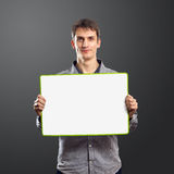 Male with write board in his hands. Isolated against different backgrounds Royalty Free Stock Photos