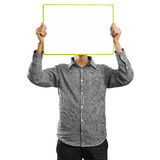 Male with write board in his hands. Against his head Royalty Free Stock Image