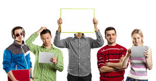 Male With Write Board In His Hands. Male with group of people, with write board in his hands, against his head Royalty Free Stock Photography