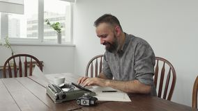 Male writer looking for inspiration and typiing stock footage
