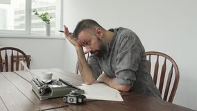 Male writer looking for inspiration and typiing. On the typewriter stock video