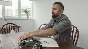 Male writer looking for inspiration and typiing. On the typewriter stock video footage