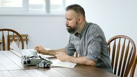 Male writer looking for inspiration and typiing. On the typewriter stock footage