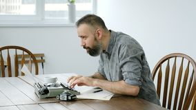 Male writer looking for inspiration and typing. On the typewriter stock footage