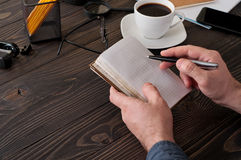 Male writes in a diary closeup on the office desktop. With business documents. Top view with copy space Stock Photography