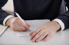 Male Writing Hands. Man writing something, signing contract, filling, taking test, student on exam Royalty Free Stock Photo