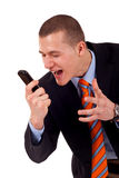 Male yelling at the cellphone. A caucasian male yelling at the cellphone over white Royalty Free Stock Photos