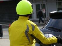 Male yellow helmet jacket motorbike. Man brigh yellow riding bike day Royalty Free Stock Photo