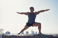 Male yoga enthusiast in warrior 2 pose. Montreal, Quebec, Canada Royalty Free Stock Photography