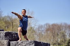 Male yoga enthusiast in warrior 2 pose. Montreal, Quebec, Canada Stock Photo