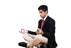 Male yoga pose. Young man in business attire in yoga lotus pose Royalty Free Stock Photos