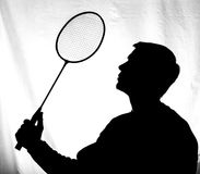 Male young athlete with a racket, badminton. Silhouette Stock Photos