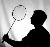 Male young athlete with a racket, badminton. Silhouette Royalty Free Stock Photos