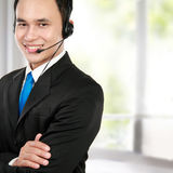 Male young call center. Closeup portrait of young call center speaking over headset Stock Photo