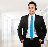Male young call center. Closeup portrait of young call center speaking over headset Royalty Free Stock Photos