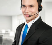 Male young call center. Closeup portrait of young call center speaking over headset Royalty Free Stock Photo