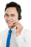 Male young call center operator. Closeup portrait of young call center operator using headset Stock Photos