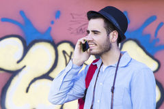 Young with the phone mobile. Male young with the phone mobile in the street of the city Stock Photo