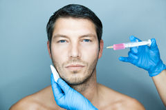 Male youth. Man beauty getting youth injection Stock Photos
