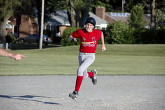 Male Youth Baseball Action Stock Photography