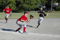 Male Youth Baseball Action. Livonia Junior Athletic League Baseball; Cardinals vs White Sox played on June 25th, 2011 in Livonia, MI. White Sox won 12-7 Royalty Free Stock Photography