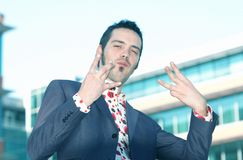 Male Yuppie Posing. A young man in smart-casual attire strikes a pose Royalty Free Stock Photo