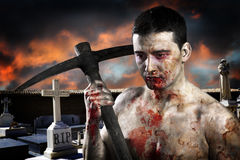 Male zombie in a cemetery, undertaker. With pick axe Royalty Free Stock Photos
