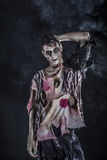 Male zombie standing on black blackground Royalty Free Stock Photo