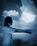 Male zombie walking at night. Halloween concept Stock Images