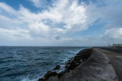 Malecon Avenue in Havana, Cuba with Caribbean Sea in Background. Malecon Avenue in Havana, Cuba Royalty Free Stock Photography