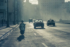 Malecon boulevard  Havana. Convertible old cars at  Malecon boulevard  Havana Royalty Free Stock Images