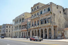 Malecon drive. Old American car driving along the Malecon in Havana, Cuba Stock Images