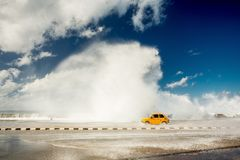 Malecon, Habana, Cuba. Waves splashing a car Stock Images