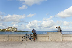 Malecon, Havana. Two fishermans in Malecon street, Havana, Cuba Royalty Free Stock Photography